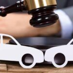 gavel over image of two cars