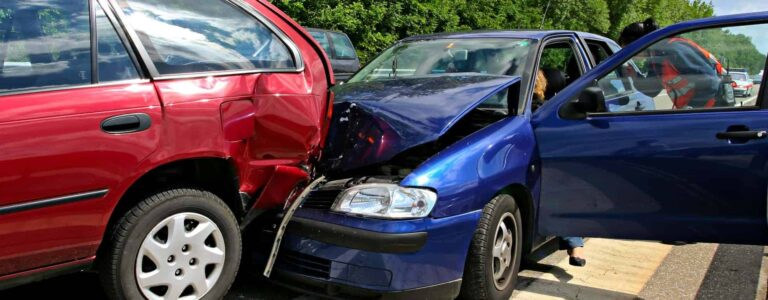 rear end car accident with a blue and red car